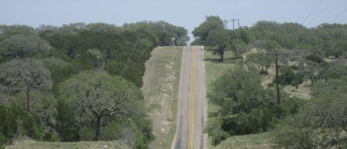 Rolling_highway_west_of_Burnet_County,_TX_IMG_2010